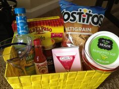 Perfect Mexican-themed girls' night giveaway basket for a #bridal shower: margarita mix, airplane bottles of tequila, tortilla chips, salsa, fajita kit, taco sauce, margarita glasses, salt and a cocktail recipe book. #weddings #bridesmaids