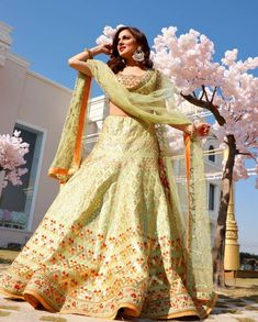 Are you bored of seeing those same reds and pinks lehenga design and are looking for something unique and something off-beat? Then Lime green lehenga design is all set to amuse you with its beauty!