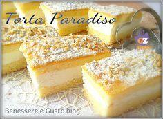 Torta ParadisoUova intere grandi: 3 Farina 00: 80 g Fecola di patate: 80 g Burro: 120 g Zucchero semolato: 150 g Buccia di limone grattugiata, in alternativa Aromi a piacere Lievito per dolci: due cucchiaini Panna Vegetale da montare, (tipo Hopla): 300 g Cioccolato bianco: 1 tavoletta da 100 g Zucchero a velo e granella di nocciole per guarnire Procedimento: