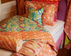 love the mix of patterns in this girl's bedding collection