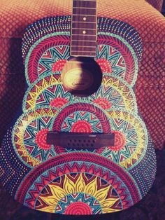 Guitar make over. Fun little piece for the living room - maybe?