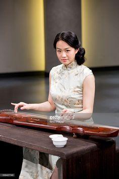 Stock-Foto : Young Woman Playing the Guqin