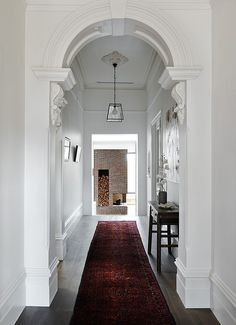 Long hallway connects the old and new elements of the home - Decoist