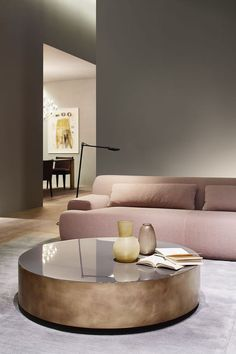warm minimalism | low dusty pink sofa | round copper coffee table | minimal living room | high ceilings | Make the look your own with an IKEA Söderhamn sofa with a pink Bemz sofa cover