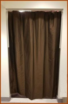 Simple curtain & rod used in locker room @ BGSU men's basketball team locker room.