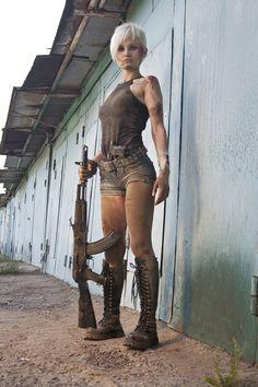 Costume + Character - tank top, big boots, short shorts and a cool gun.