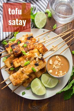 This flavor-packed vegan satay is made with skewered tofu cubes that are soaked in zesty lemongrass marinade, baked and served with luscious peanut dipping sauce! A delicious Thai inspired main dish that's easy to make and a crowd-pleaser! Tofu Recipes, Vegan Dinner Recipes, Whole Food Recipes, Vegetarian Recipes, Cooking Recipes, Vegetarian Pizza, Brunch Recipes, Delicious Recipes, Recipies