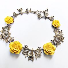 NWT Eva Mendes NY&Co Yellow Rose Necklace This NY&Co Necklace by Eva Mendes is absolutely stunning. Yellow roses mixed with gold scroll pieces. Has an extender chain. New with tag still attached. Questions? Please ask. Sorry, no trades. Bundle for a discount! New York & Company Jewelry Necklaces