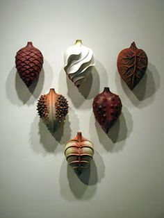 Clay pods - amazing handwork. I like the one that looks like a heart.