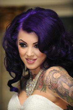 A creepy and elegant gothic wedding | Offbeat Bride Goth gothic rockabilly pinup alt punk purple hair curly spiral curls wedding hair#Repin By:Pinterest++ for iPad#
