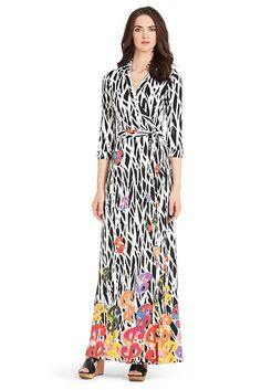Every lady should have a #DVF wrap dress. Of course for me, they must be long. Featured: an awesome Warhol print.