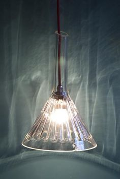 Retrouvius Reclamation and Design.  Moulded glass funnel lights, good for science kitchen theme.