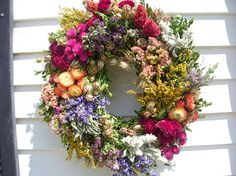 Large herb wreath on vine filled with a variety of dried herbs