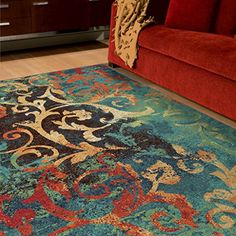 Watercolor Scroll offers a modern vibrant flair. This rug offers the Contemporary watercolor style that blends vibrant colors with a beautiful leaf...