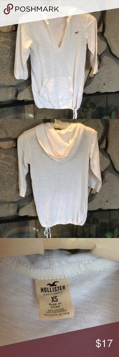 Hollister V-neck hoodie top White v-neck hoodie shirt with 3/4 sleeves, drawstring bottom hem.  Nice light weight comfortable top. Hollister Tops