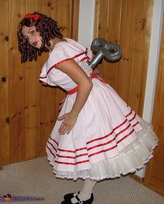 Wind Up Doll Costume - a couple years ago I was a doll for Halloween, may need to pull that dress out again and use this idea for the key - much better than the tag board cutout I made before.