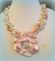 Focal of polymer clay with vintage earring as the centerpiece.  Necklace is wire/bead crochet.