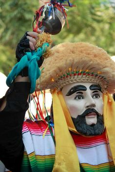 """""""Parachico"""" dancer wearing a mask carved in wood on the feast of Saint Sebastian martyr in the municipality of Chiapa de Corzo, Chiapas."""