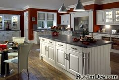 Cranberry walls, white cabinets, dark counters.  :)