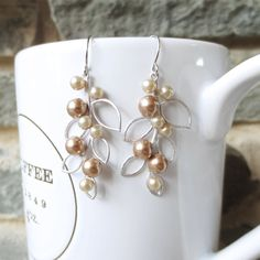 Pearl Leaf Dangle Earrings - Silver Drop Earrings, Wedding Jewelry, Bridesmaid, Bride, Bronze Champagne Pearl, Leaf Pendant, Personalized. $18.00, via Etsy.