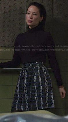 Joan's blue and black textured print skirt on Elementary.  Outfit Details: http://wornontv.net/47569/ #Elementary
