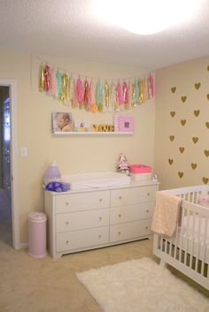 Tassel garland over the changing table - love the look!