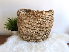 Woven Straw Top Handle Handbag / Straw Beach Tote / Raffia Market Bag / Hand Woven Basket Bag  Special vintage HAND woven straw basket bag I believe this bag may have originated from Africa Its a great bag for the beach because the sand falls right through Great also for the market  Measures: 14 tall x 14 wide CONDITION REFERENCE CHART RATING: Excellent has one small breakage at the top ring. Gorgeous old bag  Thanks for looking and check out my other listings at…
