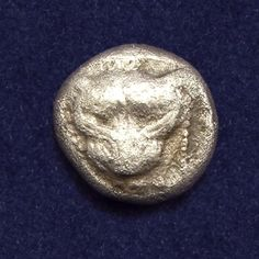 Ancient Greece, Ionia, Miletos, AR 1/8 Stater (Triobol). Struck: late 6th - early 5th century BC. Head of lion facing in dotted square.