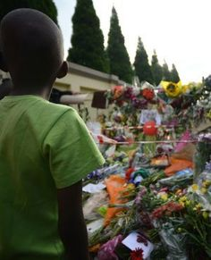 A boy looks at a wall of flowers laid by mourners outside former president Nelson Mandela's home in Johannesburg. (Filippo Monteforte, AFP)
