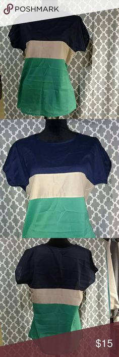 Three-tone, short sleeve Blouse NWOT. Navy, Tan, and Green. Very light fabric/See-through. New/Never worn. Excellent Condition!! Liva Girl Tops Blouses