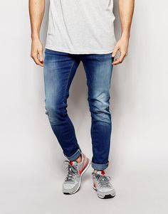 "Jeans by Blend Firm stretch denim Mid wash with fading Zip fly Skinny fit - cut closely to the body Machine wash 99% Cotton, 1% Elastane Our model wears a 81cm/32"" regular and is 185.5cm/6'1"" tall"
