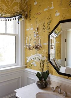 Love the mustard wallpaper and damask window treatment - powder room by Robin Pelissier
