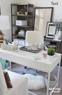 Chic home office features cabinets and a framed cork board placed