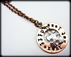 autism awareness piece  In hand-stamped copper.