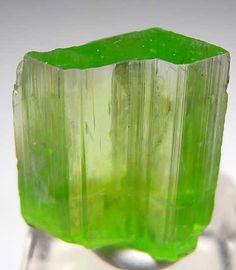 Tremolite.   Merelani Hills, Lelatema Mountains, Arusha Region, Tanzania thumbnail - 1.8 x 1.4 x 0.5 cm.   Gemmy, vivid green Tremolite with a perfect, glassy termination.