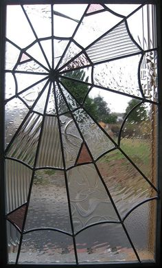 Spider Web Stained Glass Window - this is cool! What a good idea.