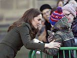 Kate Middleton embraces a young man in the crowd after Meghan Markle was praised for approach