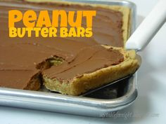 A FREE Peanut Butter Bars recipe from Six Sisters' Stuff! #recipe #dessert 1 c butter; 1 c sugar; 1 c brown sugar; 1 tsp vanilla; 2 eggs; 2 1/2 c peanut butter (divided); 2 c oats; 2 cups flour; 1 tsp baking soda; chocolate frosting. Cream butter and sugars. Add vanilla, eggs, 1 c peanut butter. Add oats, flour, baking soda, salt. Press dough evenly into a greased 13X8-inch pan. Bake at 350° for 15 minutes. Spread remaining PB on top. Let cool; then spread frosting on top.