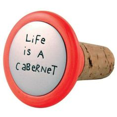 Our Name Is Mud by Lorrie Veasey Life/Cabernet Wine Stopper , 2-1/4-Inch by Enesco. $7.90. Dishwasher Safe. Bright bold multi color. Against manufacturing defects. Cork, Earthenware, Stone Resin, Contains 40-50% Calcium Ca. Wine Stopper. Need a great little gift? Put a Cork in It. This witty wine cork designed by Lorrie Veasey is the perfect excuse not to polish off the whole bottle. This item was created from earthenware clay and is glazed a brilliant coral red. The sil...