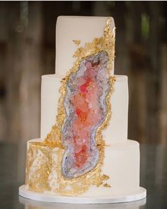 """This week the internet has been abuzz with a new trend in wedding cakes. While """"naked cakes"""" have been all the rage the last few years, something new has been popping up from many a cake baker, and they will definitely rock your world. Enter: the geode cake. In case you're not familiar, geodes are volcanic creations that look like normal rocks on the outside, but when you split them open, they reveal a sparkling interior. The wedding cakes you see below all use sugar rocks to get t"""