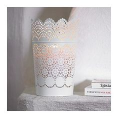 SKURAR Lantern for block candle - IKEA $5.99; Pretty and delicate.  Might be nice with flowers in the center of tables.