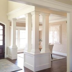 Kitchen Living Rooms Remodeling Custom columns and trims add a sense of separation to this dining room. Living Room Kitchen, Dining Room, Dining Table, Interior Columns, Room Interior, Interior Design, Moldings And Trim, Moulding, Dining Lighting