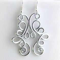 These wonderful fun earrings are made out of anodized aluminum shiny silver wire 12 gauge. Aluminum is 1/3 the weight of steel making them super