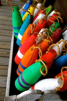 Oh boy...add a pop of colour to a country style lake house with beautiful buoys...find a cool wooden or wicker box