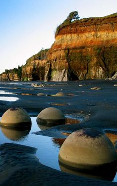 The mysterious sphere boulders on the blacksand low-tide-only beach north of the Tongaporutu River mouth NZ