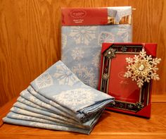 Blue tablecloth and napkins with sparkly snowflake theme, lovely blue photo frame and a snowflake ornament