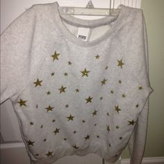 Victoria's Secret PINK grey sweat shirt Victoria's Secret PINK grey sweat shirt; With gold stars all over ⭐️⭐️⭐️⭐️ was my fave! only worn about 5 times. sooooooo cute! Size medium good condition ! NO TRADES PINK Victoria's Secret Tops