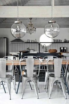 Love the metal chairs, and globes, subway tile, black cabinet.