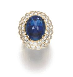Sapphire and Diamond Ring, Boucheron Centring on cabochon sapphire weighing 12.21 carats, within a double frame of brilliant-cut diamonds, s...