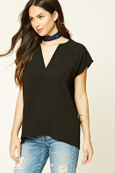 Style Deals - A textured woven top with a split neckline, short dolman sleeves, and a boxy silhouette.